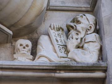 Picture of grotesque pondering a tablet of numbers